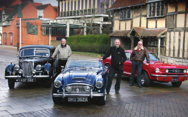 Festival organiser, Adrian Grubb (centre) with Stratford classic car enthusiast John Atkinson (left) and Tony Merrygold (right) route planner of the Test Hills Run and Managing Director of festival partner, Shakespeare Country. The cars featured (l-r) are a 1950 Riley RMA, 1963 Austin Healey 3000 MkII and a 1965 Ford Mustang GT