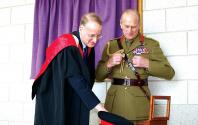 The Duke with the Principal after signing the visitors book