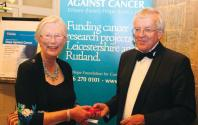 Mary Lloyd MBE presenting Peter de Voil, winner of the diamond pendant, with his prize.