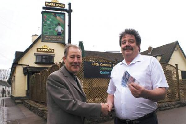 John Brewerton, handing over a cheque to Martin Allen of lutterworth age concern